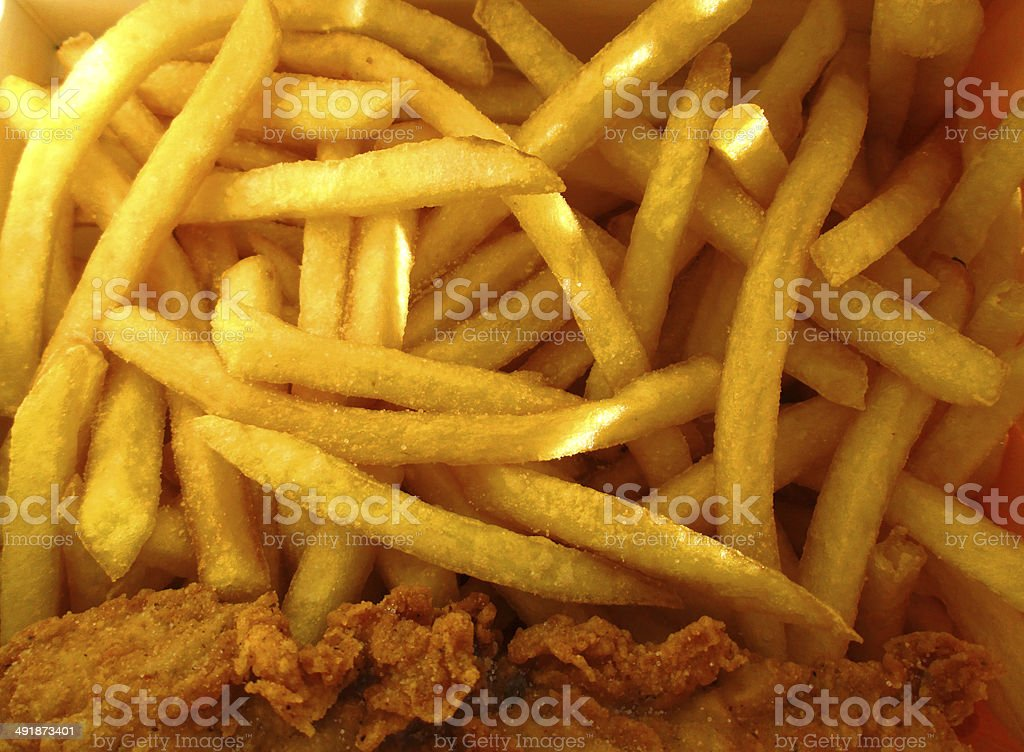Image of crunchy French fries and fried chicken, takeaway food stock photo