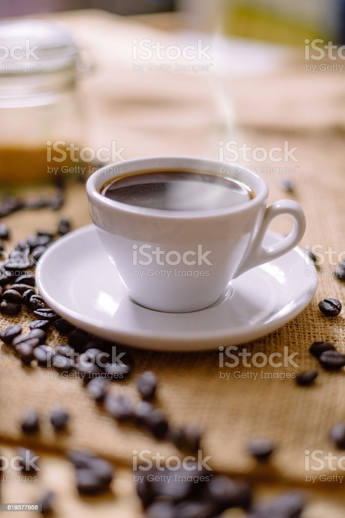Image of cup of hot black steaming coffee stock photo
