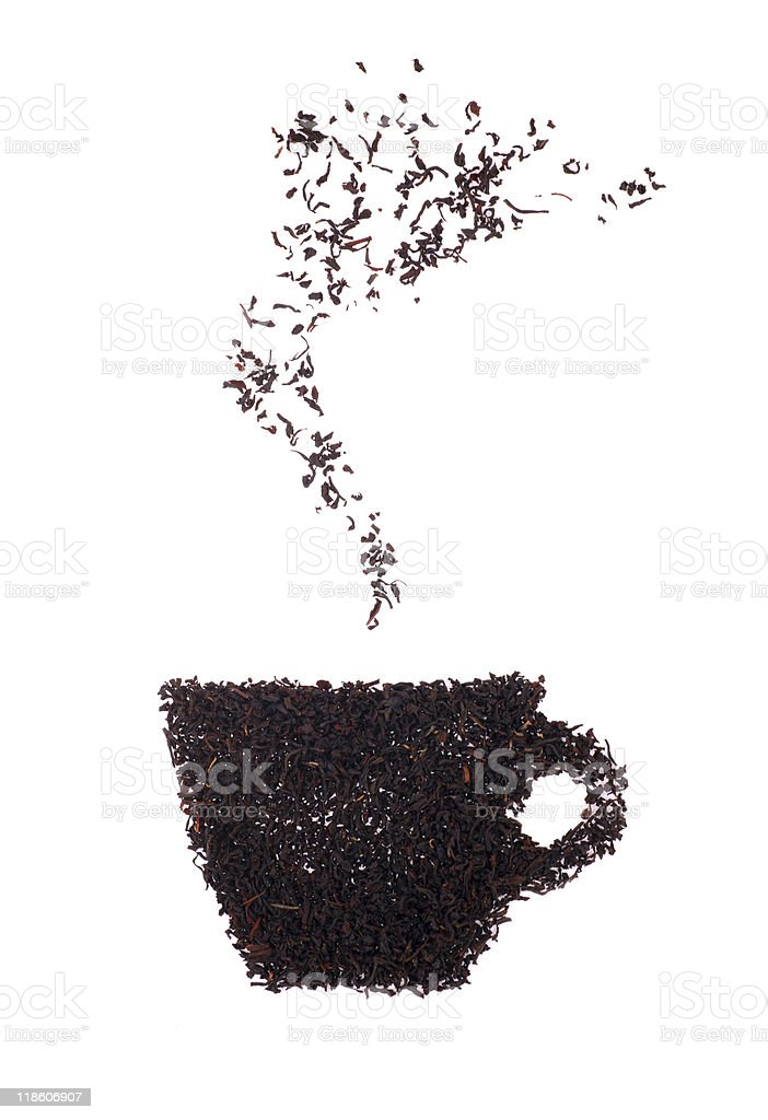 Image of cup of steaming hot tea made up of loose tea leaves stock photo