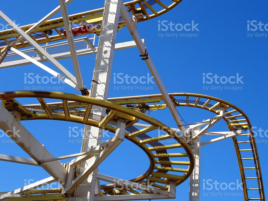 Image of curving metal railroad track on rollercoaster funfair ride stock photo