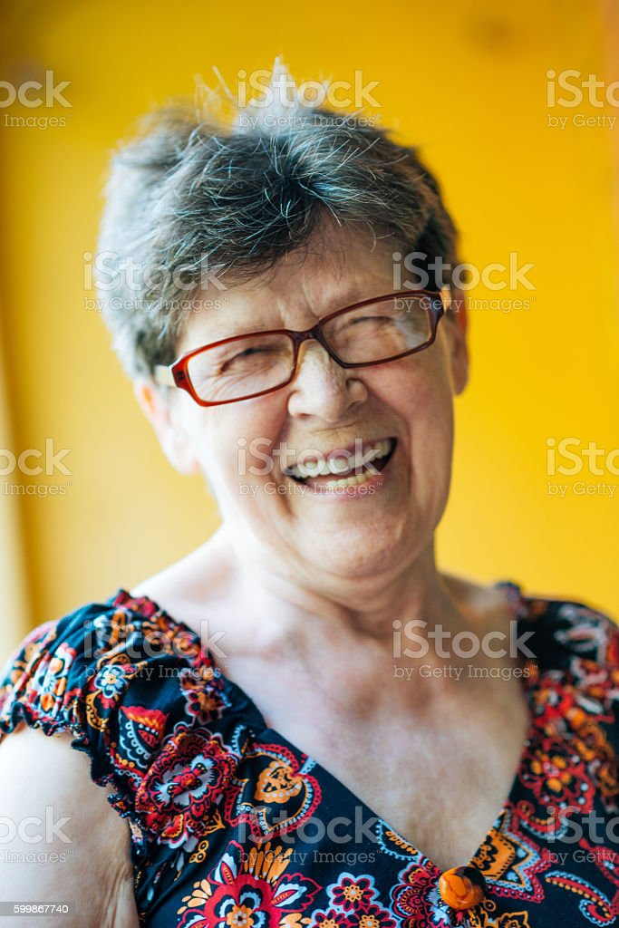 Image of cute smiling senior woman with glasses stock photo