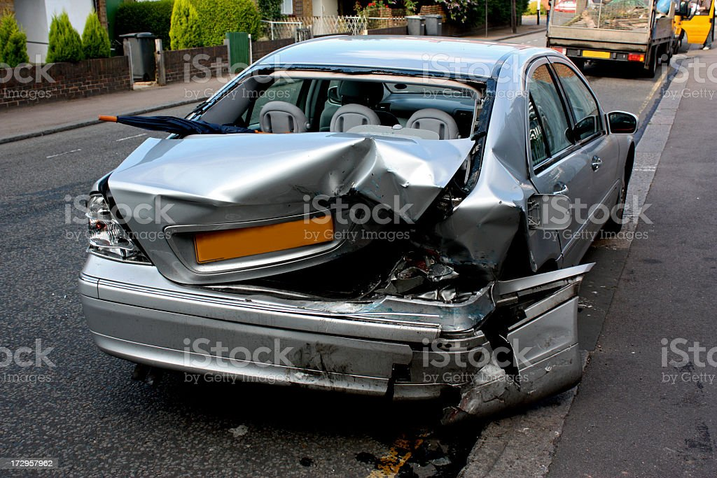 Image of damaged silver car after collision royalty-free stock photo