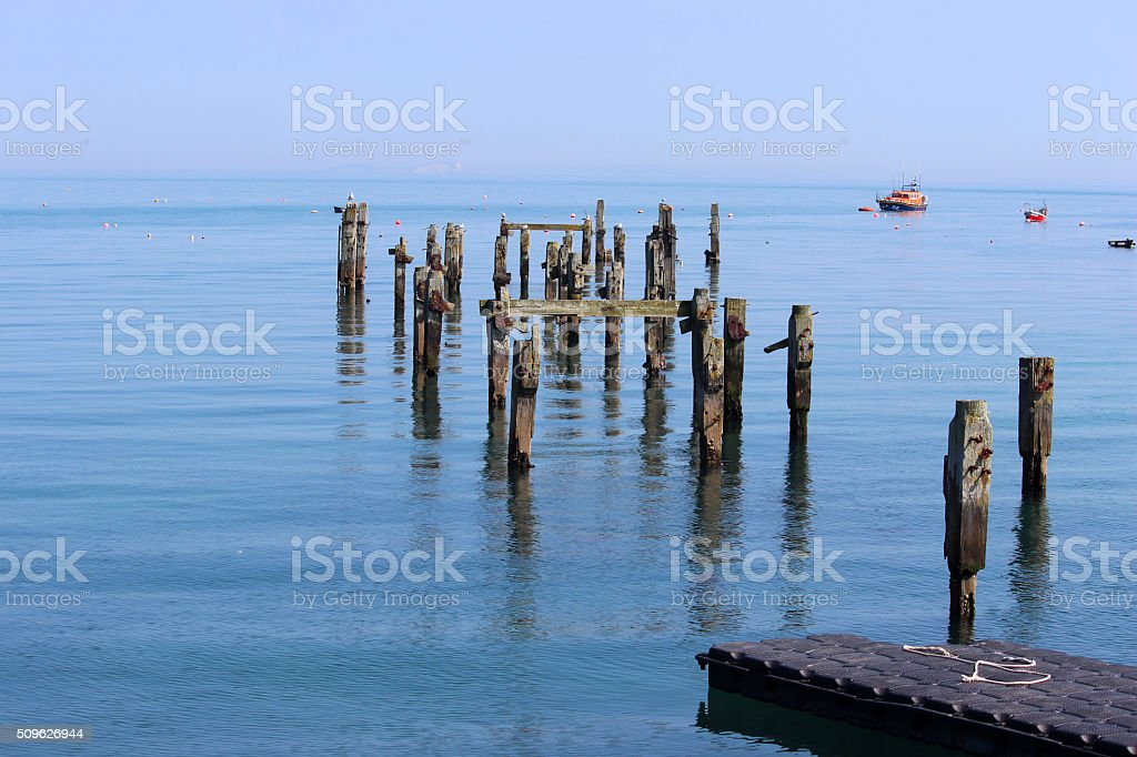 Image of decayed and broken piles of Swanage old pier stock photo