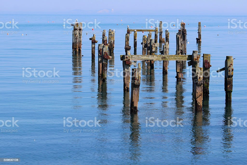Image of decaying remains of Swanage pier protruding from sea stock photo