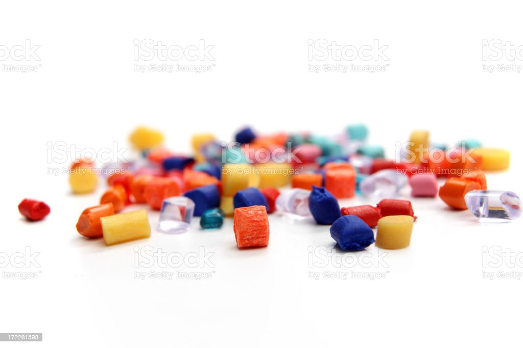 Image of different sized and colored plastic grains  stock photo