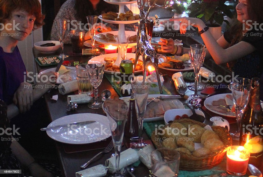 Image of dining table with Christmas buffet food at night stock photo