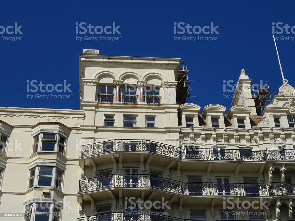 Image of Edwardian building with ornate ironwork balconies and scaffolding stock photo
