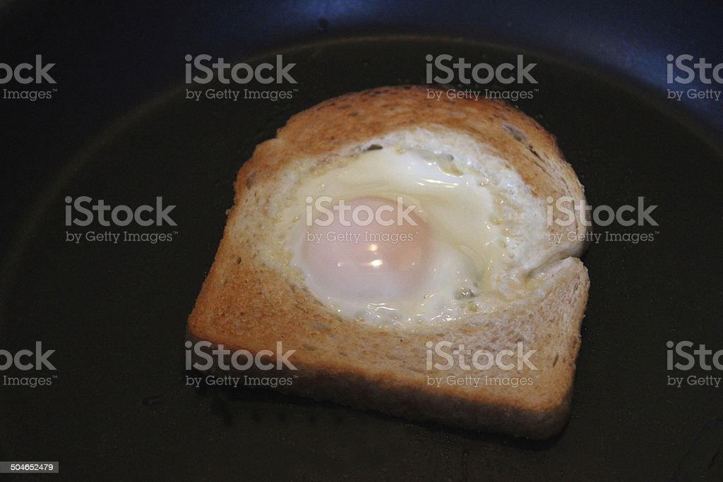 Image of egg in hole toast / fried bread with egg stock photo