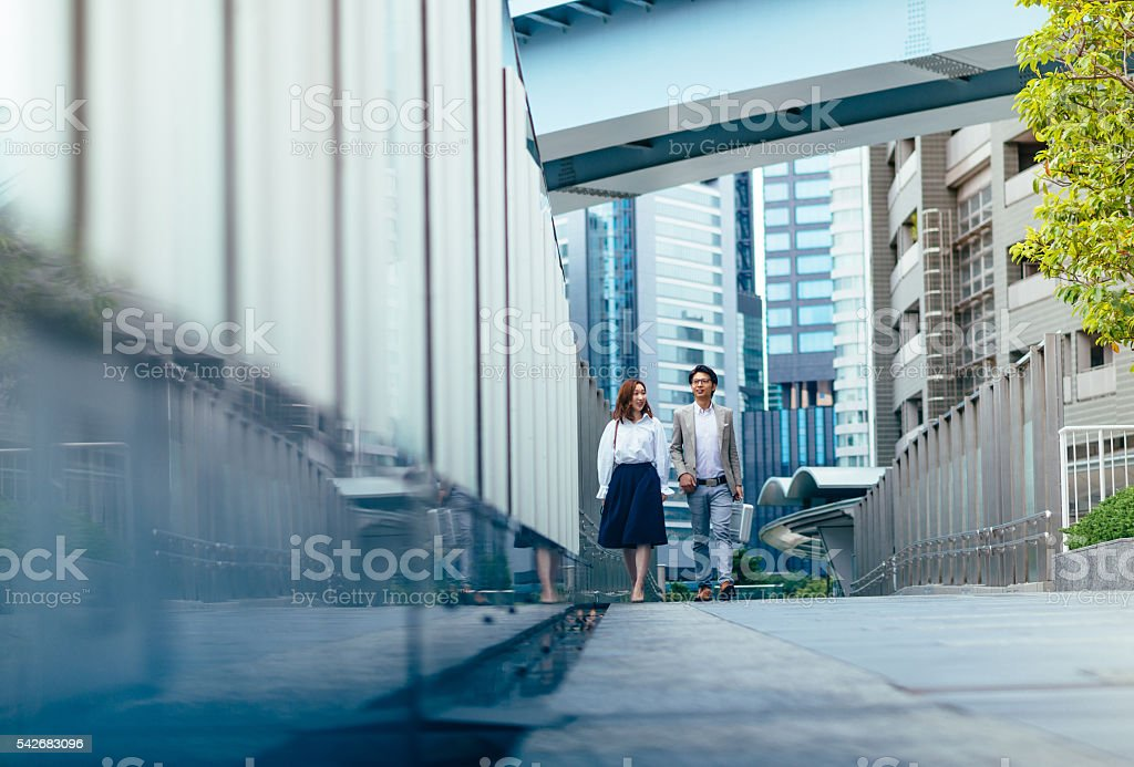 Image of employees going to work in Tokyo, Japan stock photo
