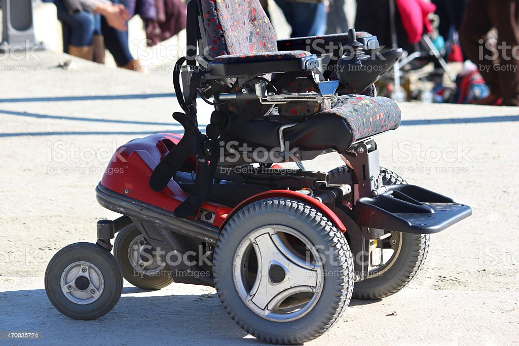 Image of empty, modern electric powered wheelchair seat on pavement stock photo