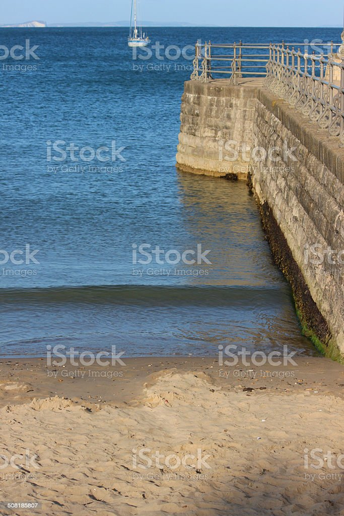 Image of English seaside, stone jetty / pier, Victorian railings, harbour stock photo
