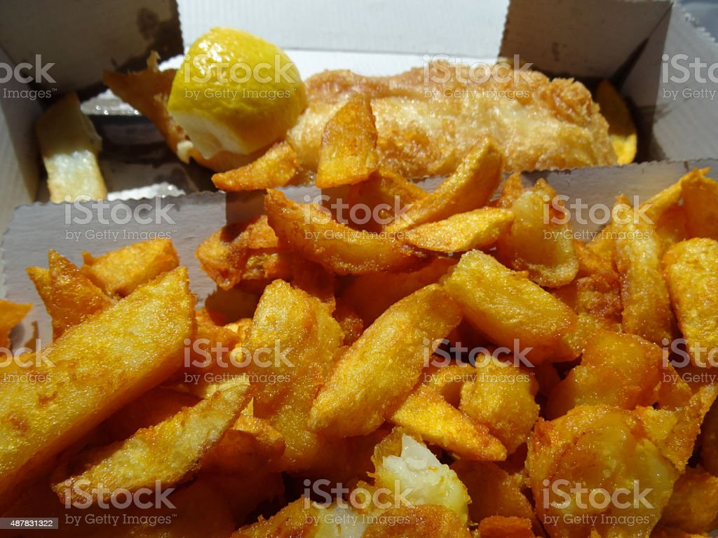 Image of fish / cod with battered chips / crispy potato wedges stock photo