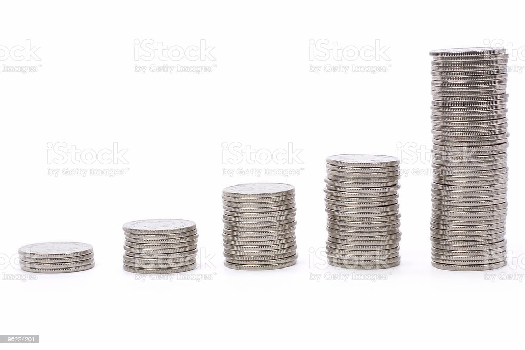 Image of five stacks of coins in order stock photo