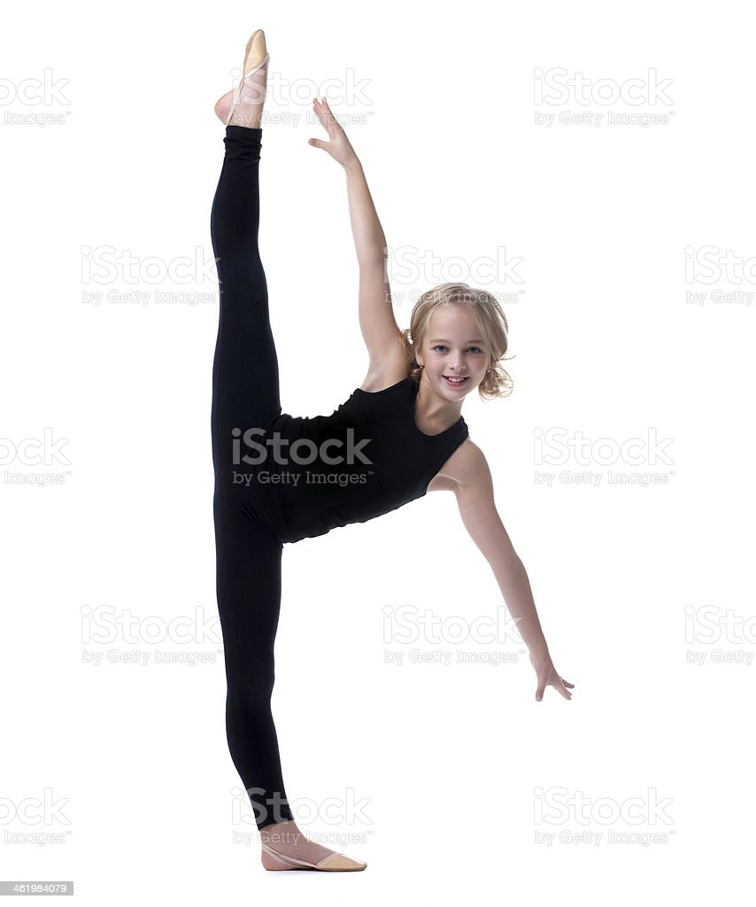 Image of flexible little girl doing vertical split stock photo