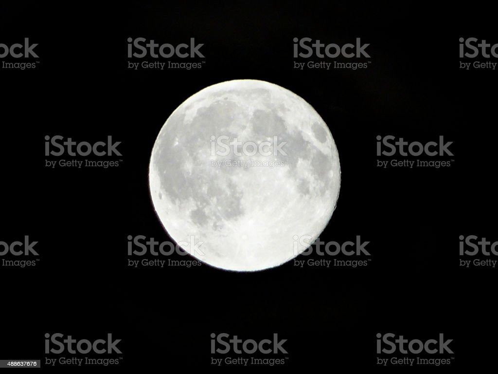 Image of full-moon shining in black, night-time sky without stars stock photo