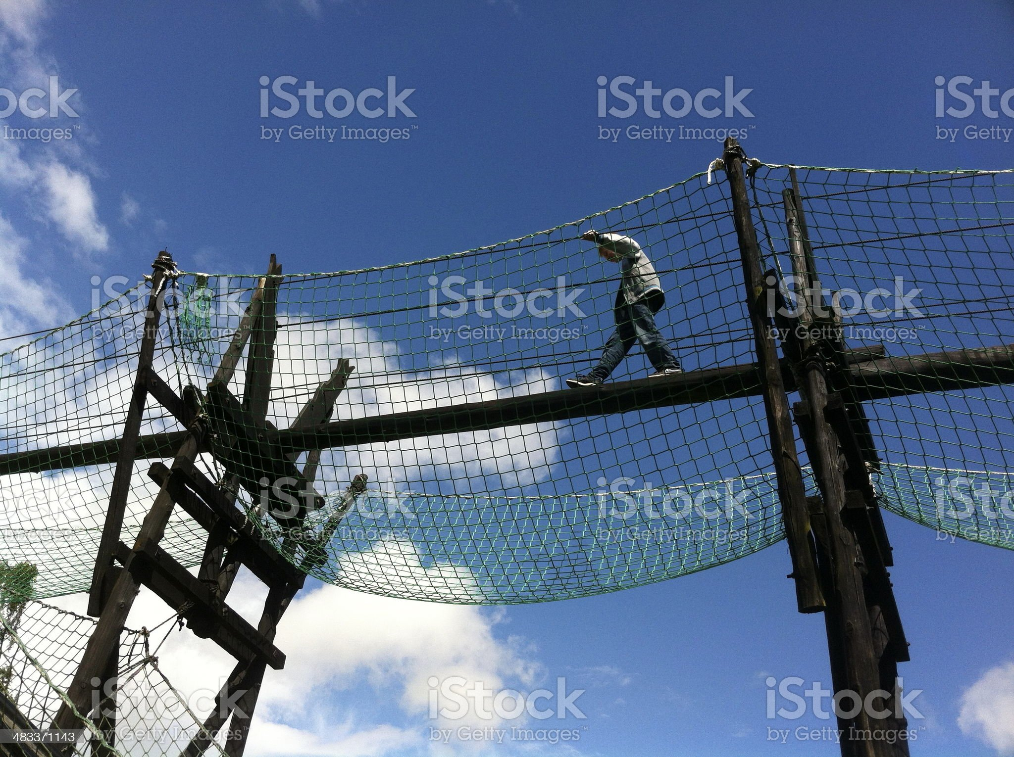 Image of girl on a aerial walkway royalty-free stock photo