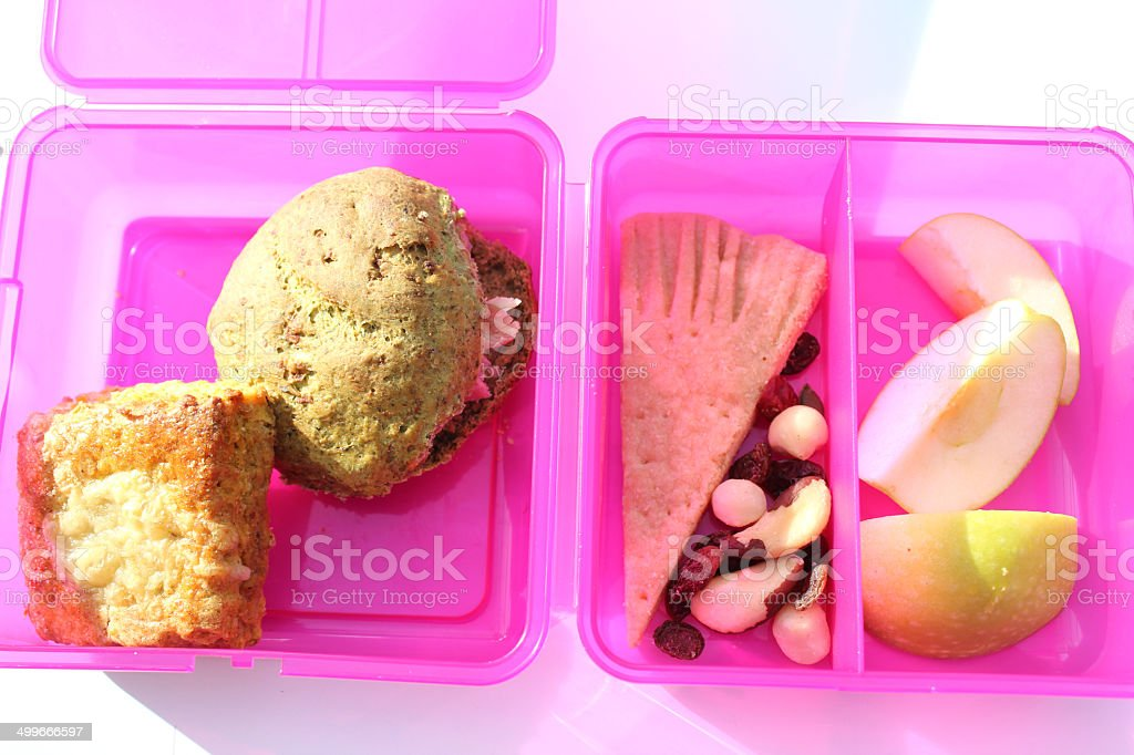 Image of girl's healthy eating pink lunchbox with wholemeal sandwich stock photo