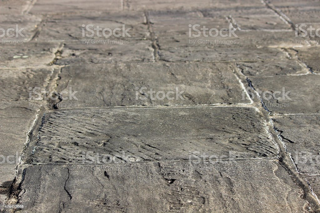 Image of grey flagstone paving slabs forming garden patio, hardscaping stock photo