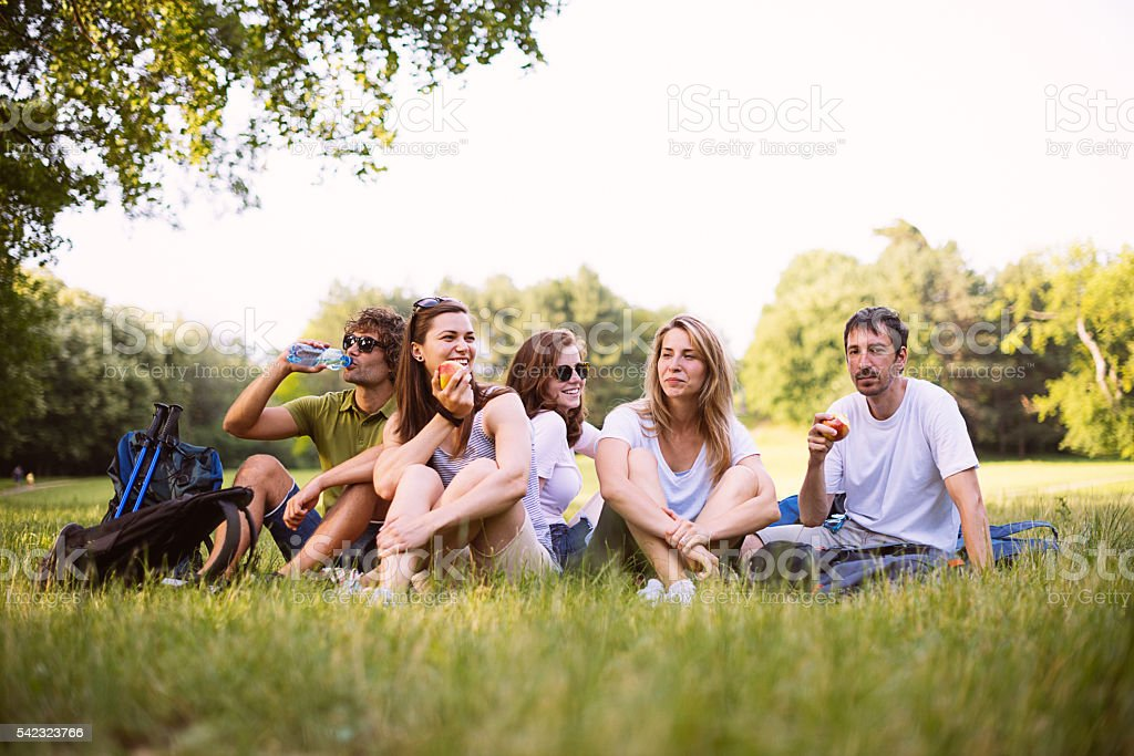 Image of group of friends in park after hiking stock photo