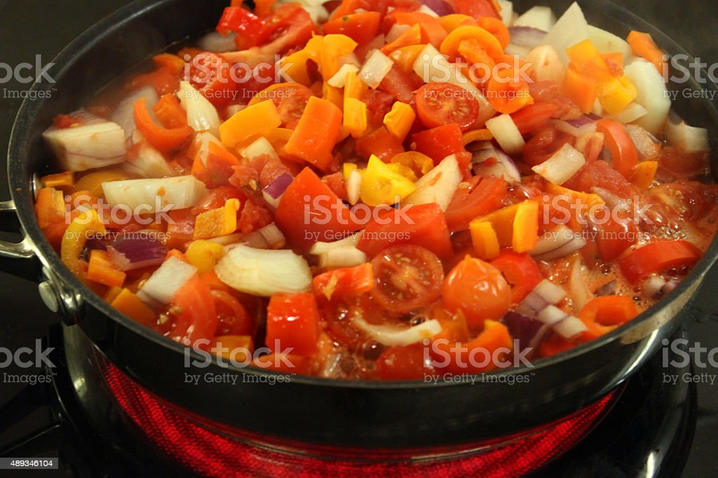 Image of halogen ceramic cooker ring with vegetables in frying-pan stock photo