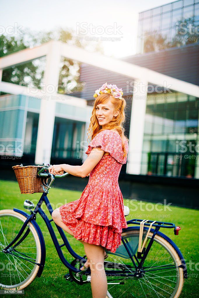 Image of happy ginger girl with retro bicycle in summer stock photo