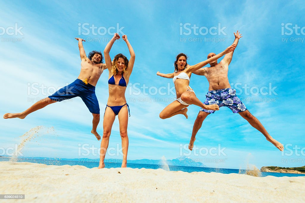 Image of happy people in swimsuits on beach in summer stock photo