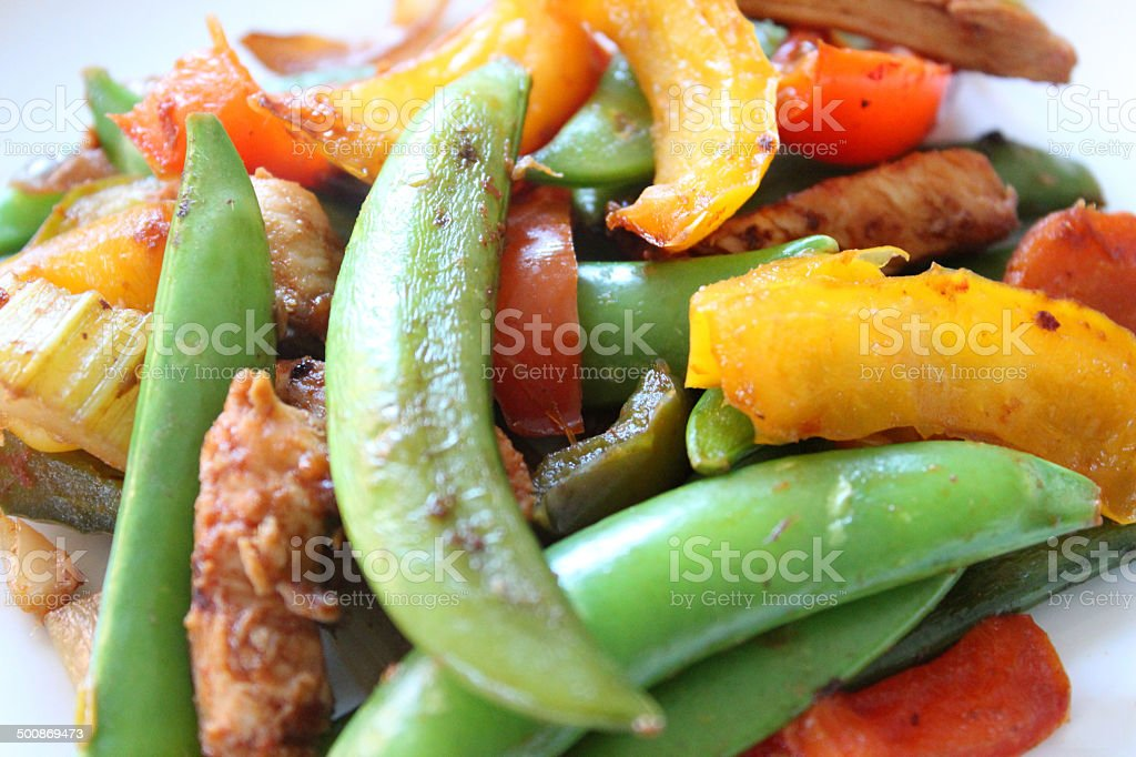 Image of healthy chicken stir fry, sugar snap peas, peppers royalty-free stock photo
