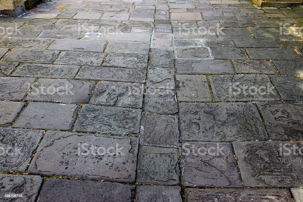 Image of historic flagstone paving, old grey flag stones stock photo