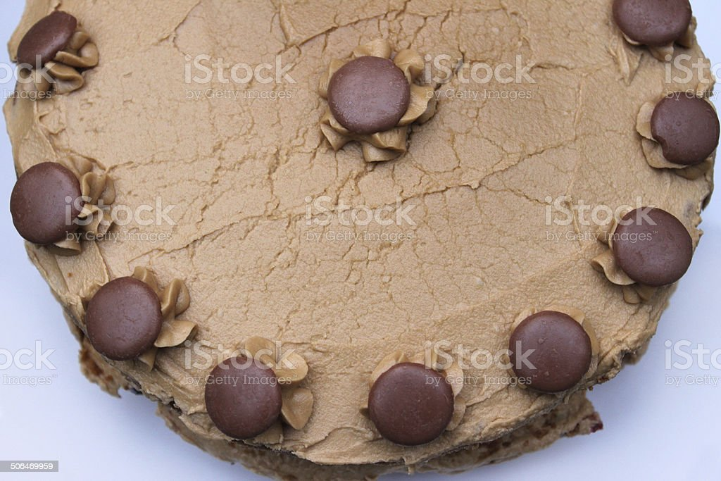 Image of homemade coffee cake decorated with cream / chocolate buttons stock photo