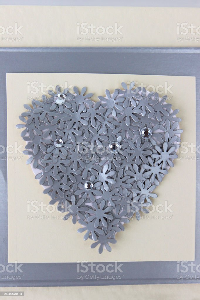 Image of homemade greetings / birthday card with flowers, silver heart stock photo