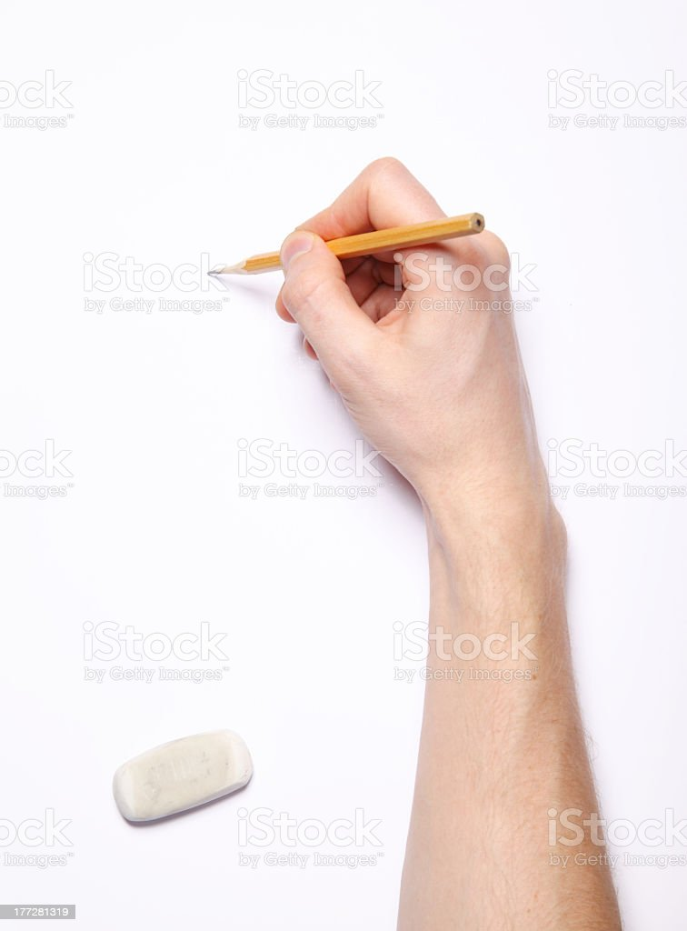 Image of human hand with pencil and eraser on white stock photo