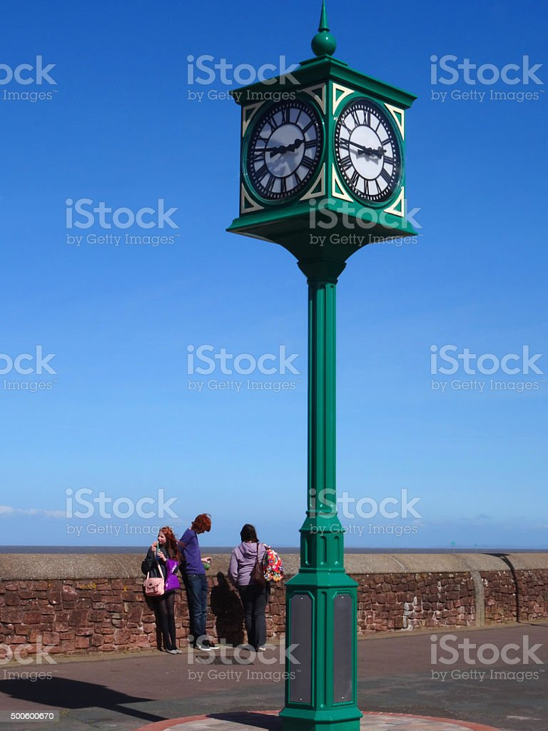 Image of iron clock tower painted green on Minehead beachfront stock photo