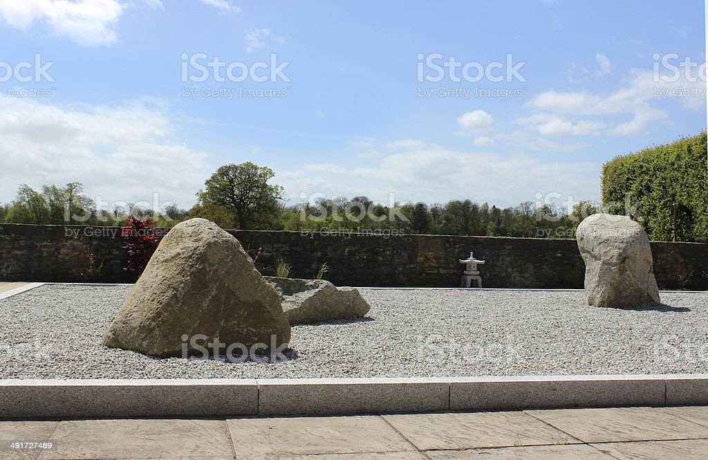 Image of Japanese Zen garden with stones, gravel, lanterns, maples stock photo