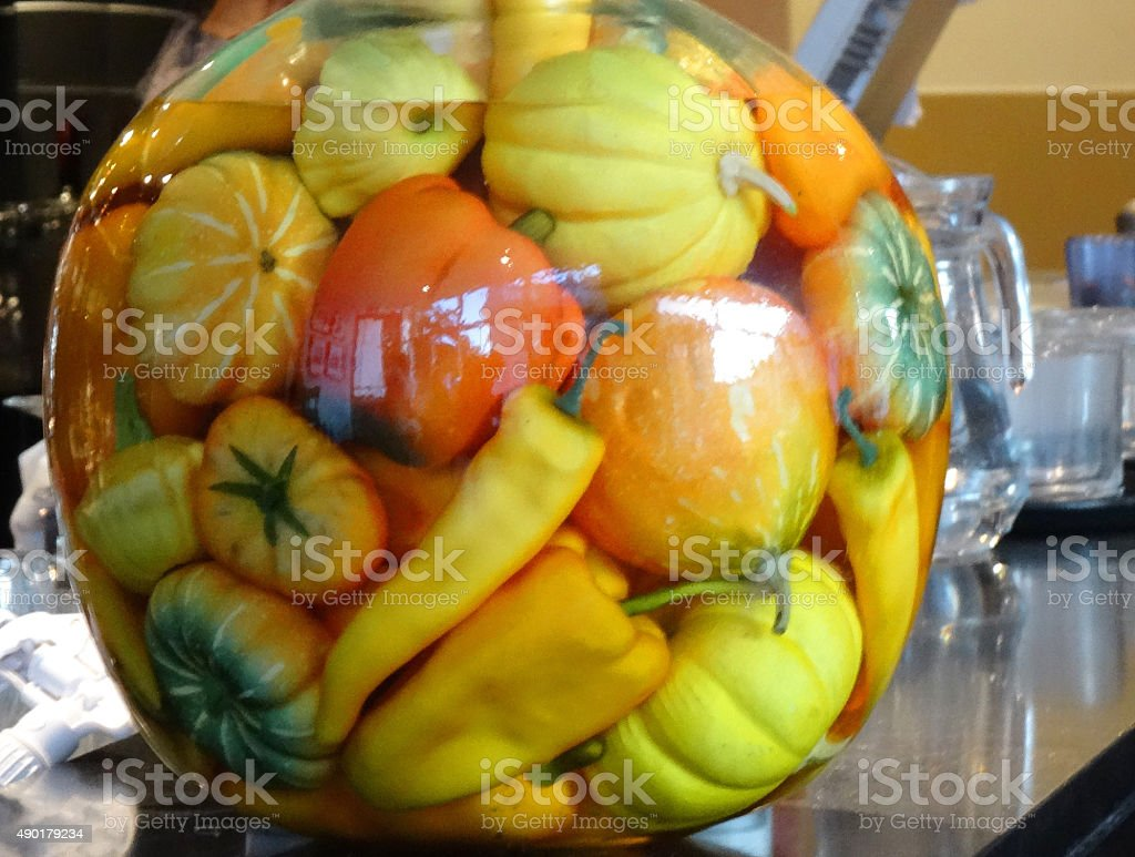 Image of jar with yellow / orange pickled gourds, peppers, chilies stock photo