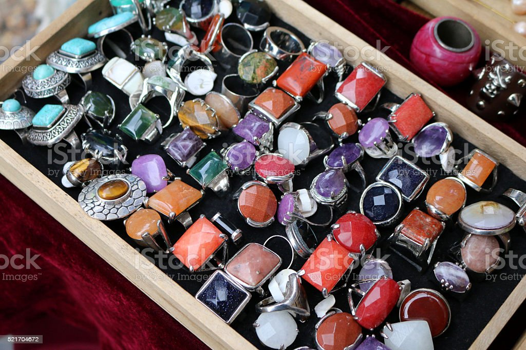 Image of jewelry tray of silver, semi-precious gemstone rings stock photo