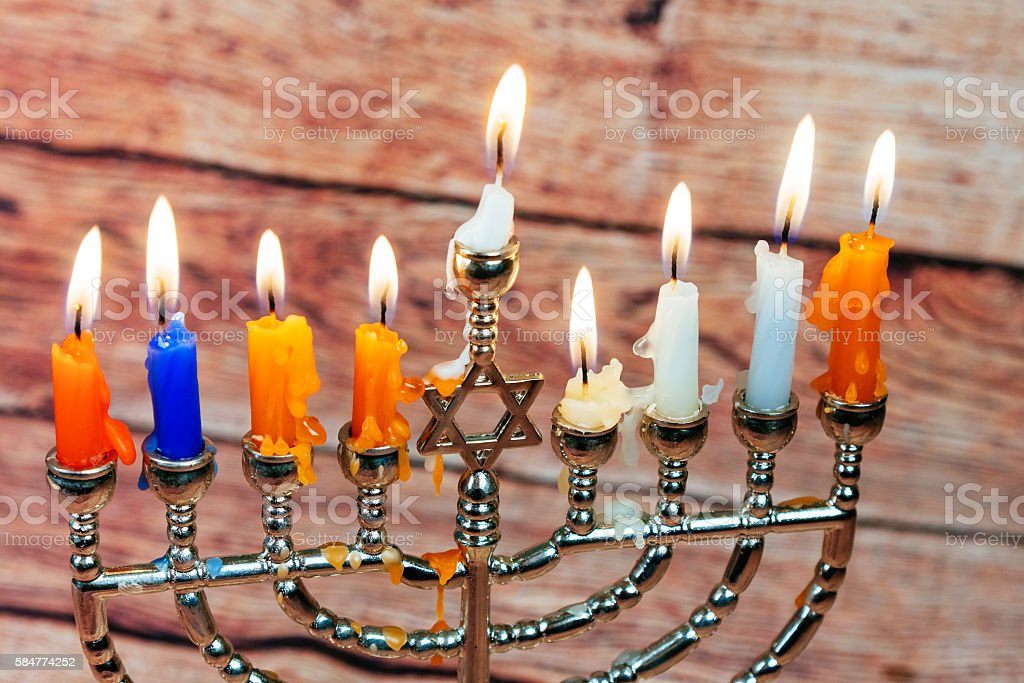 Image of jewish holiday Hanukkah background with menorah traditional candelabra stock photo