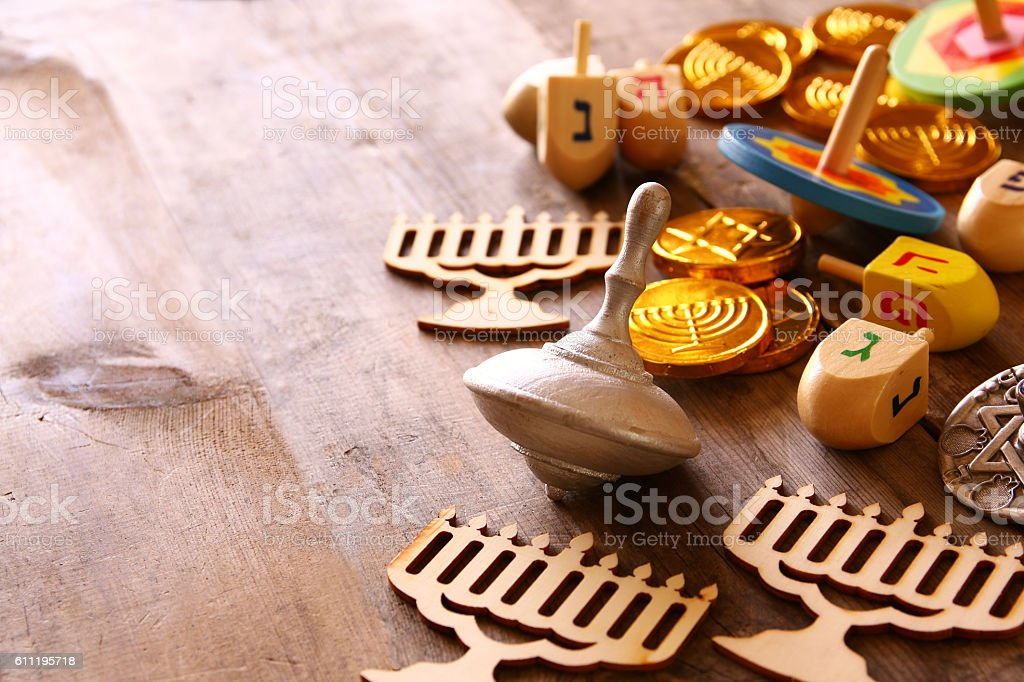 Image of jewish holiday Hanukkah with wooden dreidels colection and...