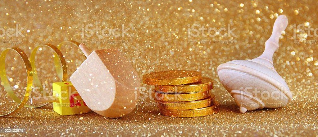 Image of jewish holiday Hanukkah with wooden dreidel stock photo