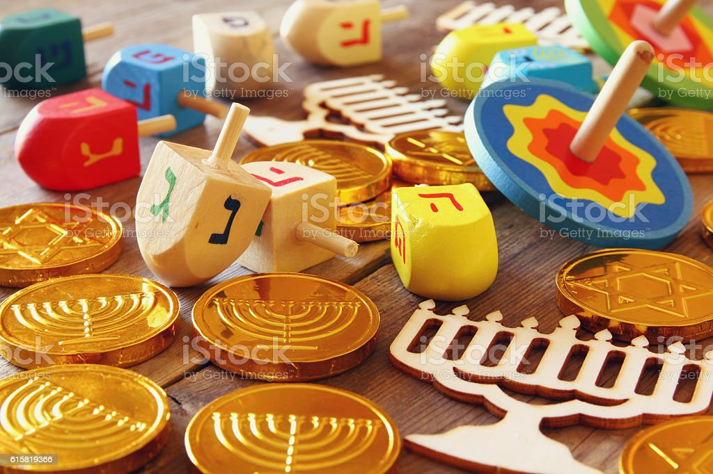 Image of jewish holiday Hanukkah with wooden dreidels stock photo