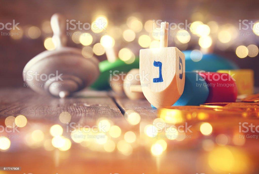 Image of jewish holiday Hanukkah with wooden dreidels royalty-free stock photo