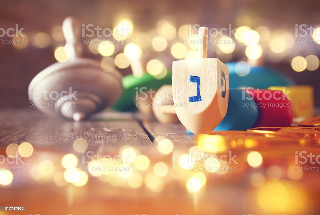 Image of jewish holiday Hanukkah with wooden dreidels stock photo