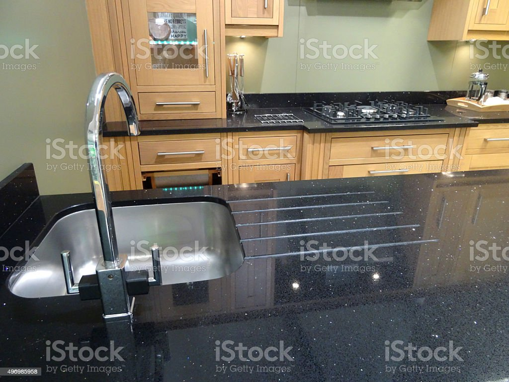 Image of kitchen with granite worktop / countertop surface, sink draining-board stock photo