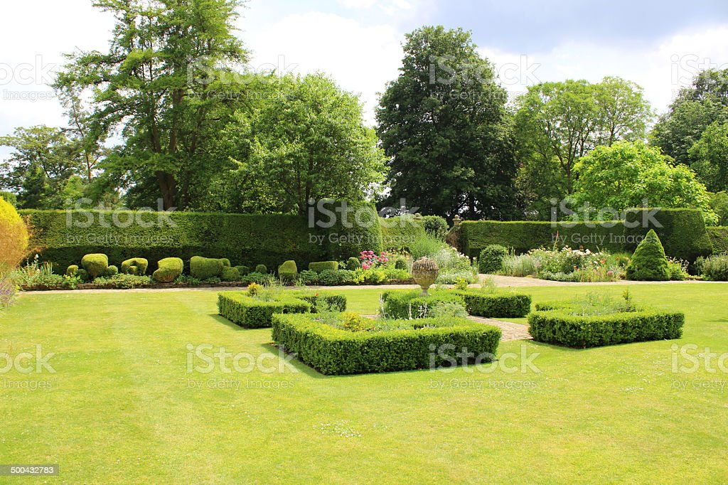 Image of landscaped knot garden with geometric clipped buxus hedges stock photo
