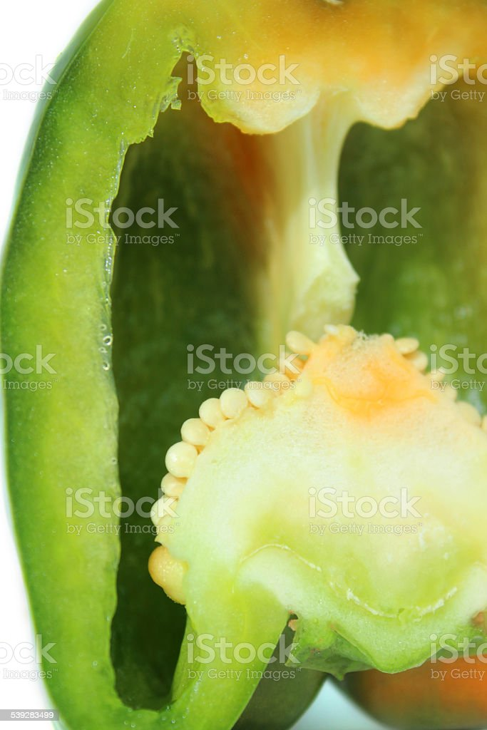 Image of large green pepper / capsicum, raw-vegetable, sliced in half stock photo