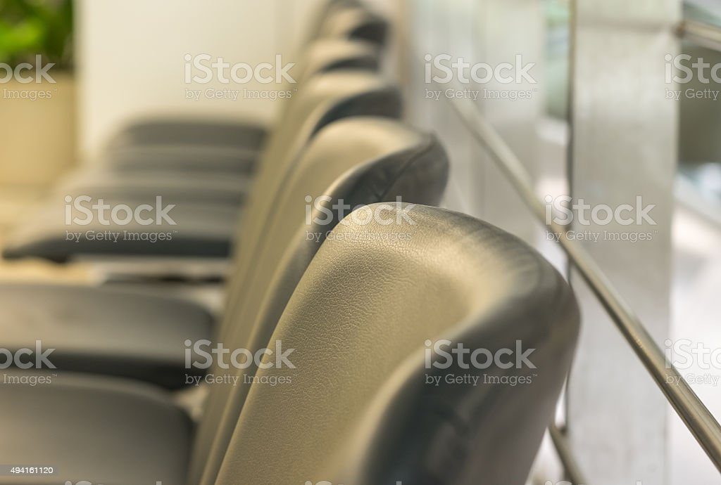 Image of leather seats in waiting area stock photo