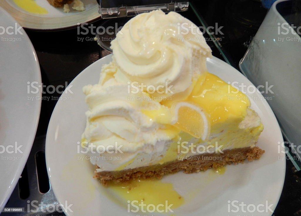 Image of lemon chesecake with cream, lemon sauce, indulgent dessert stock photo