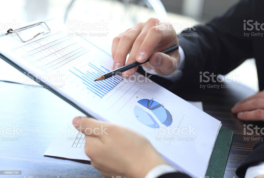 Image of male hand pointing at business document during discussion stock photo