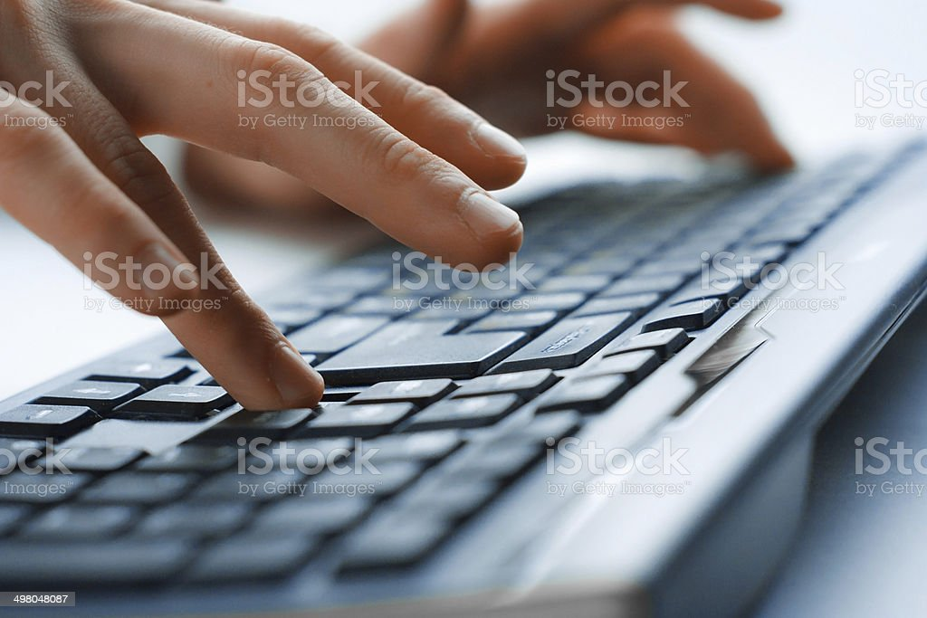 Image of man's hands typing. Selective focus stock photo
