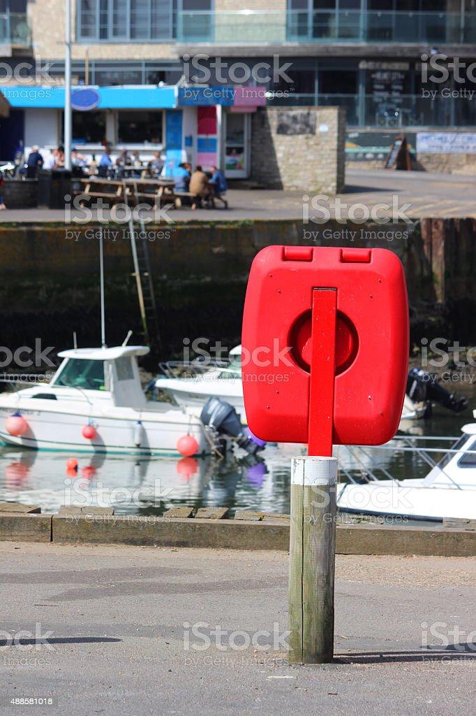 Image of marina boats and red lifering donut / life-buoy life-preserver stock photo