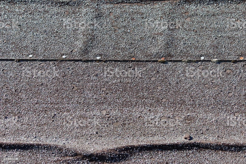 Image of mineral felt covering shed roof, creased and tacked stock photo
